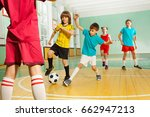 children playing football in... | Shutterstock . vector #662947213