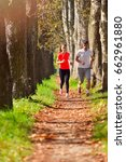 young couple jogging in park at ... | Shutterstock . vector #662961880