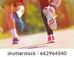 young couple jogging in park at ... | Shutterstock . vector #662964340