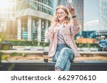 young businesswoman is sitting... | Shutterstock . vector #662970610