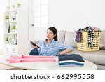 young pretty housewife folding... | Shutterstock . vector #662995558