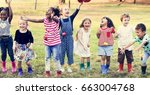 group of diverse kids playing... | Shutterstock . vector #663004768
