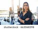 serious business woman in front ... | Shutterstock . vector #663068398