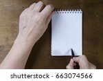 hand writing on empty notepad... | Shutterstock . vector #663074566