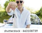 young man with the keys to the... | Shutterstock . vector #663108739