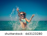 happy child playing in the sea. ... | Shutterstock . vector #663123280