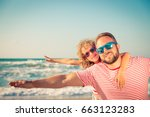 happy family on the beach.... | Shutterstock . vector #663123283