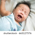 asian baby cry from hungry ... | Shutterstock . vector #663127576
