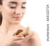 Small photo of Beautiful young woman with giant Achatina snail on white background