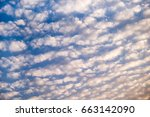 Small photo of Sunset sky with white clouds (altocumulus cloud). Golden hour. Cloudscape.