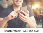 happy man using smartphone at... | Shutterstock . vector #663155560