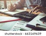 businessman calculating... | Shutterstock . vector #663169639