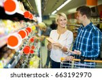 smiling adult customers with... | Shutterstock . vector #663192970