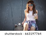 teen female skater sitting on... | Shutterstock . vector #663197764