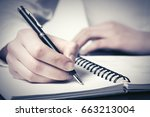 business woman writing in... | Shutterstock . vector #663213004