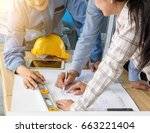 a group of engineers are... | Shutterstock . vector #663221404