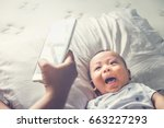 high angle shot of happy mother ... | Shutterstock . vector #663227293