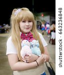 Small photo of Sheffield, UK - June 04, 2017: Cosplayer dressed as a character from the anime and manga 'Love Live' at the Yorkshire Cosplay Con at Sheffield Arena.