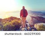 man on the sheer cliff | Shutterstock . vector #663259300
