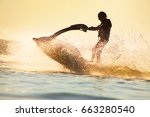 young man drive on the jet ski... | Shutterstock . vector #663280540
