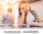 bored girl studying at table... | Shutterstock . vector #663283840