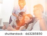 happy family using tablet pc on ... | Shutterstock . vector #663285850