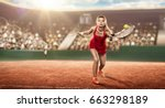 Small photo of female tennis player with a racket on a tennis court in action