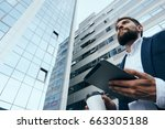 businessman with tablet ... | Shutterstock . vector #663305188