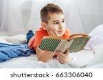 little student reading a book.... | Shutterstock . vector #663306040