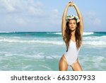 sexy woman in white swimsuit is ... | Shutterstock . vector #663307933