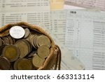 savings coins in sack. show... | Shutterstock . vector #663313114