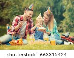 happy family of three... | Shutterstock . vector #663315424