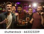 four happy men holding beer...   Shutterstock . vector #663323209