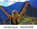 young woman with raised arms on ... | Shutterstock . vector #663329008