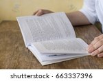 the girl is reading a book | Shutterstock . vector #663337396