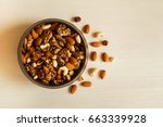 mixed nuts in a metal brown... | Shutterstock . vector #663339928