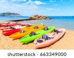 Colourful Kayaks On Sandy Es...