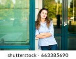 young woman in blue shirt... | Shutterstock . vector #663385690