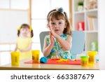 preschooler girl having fun... | Shutterstock . vector #663387679
