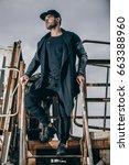 fashionable man in urban... | Shutterstock . vector #663388960