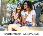 two female friends hangout at... | Shutterstock . vector #663392668