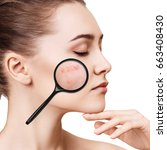 Small photo of Young girl shows acne with magnifying glass.