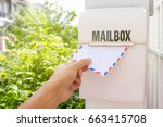 hand remove mail from mail box | Shutterstock . vector #663415708