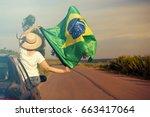 woman holding brazil flag  ... | Shutterstock . vector #663417064