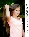 young teenage girl in the park... | Shutterstock . vector #663419428