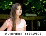 young teenage girl in the park... | Shutterstock . vector #663419578