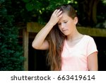 young teenage girl in the park... | Shutterstock . vector #663419614