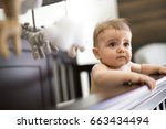 a toddler baby in the crib on...   Shutterstock . vector #663434494