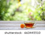red tea and flower on wooden... | Shutterstock . vector #663445510