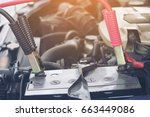 charging car with electricity... | Shutterstock . vector #663449086